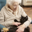 Senior Woman Relaxing In Chair At Home With Pet Cat — Stock Photo