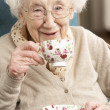 Senior Woman Enjoying Cup Of Tea At Home — Stock fotografie #11881293