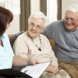 Senior Couple In Discussion With Health Visitor At Home — Stock Photo #11881322