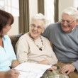 Senior Couple In Discussion With Health Visitor At Home — Stock Photo #11881323