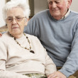 Senior Man Consoling Wife At Home — Stock Photo