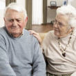 Senior Woman Consoling Husband At Home — Stock Photo #11881344