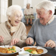 Senior Couple Enjoying Meal Together — 图库照片