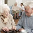 Couple Playing Dominoes At Day Care Centre — Stock Photo