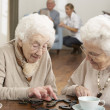 Two Senior Women Playing Dominoes At Day Care Centre — Stock Photo #11881355