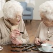 Two Senior Women Playing Dominoes At Day Care Centre — Stock Photo #11881356