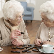 Stock Photo: Two Senior Women Playing Dominoes At Day Care Centre