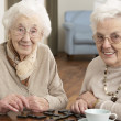 Two Senior Women Playing Dominoes At Day Care Centre — Stock Photo