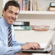 Stock Photo: Man Working From Home Using Laptop