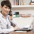 Woman Working From Home Using Laptop On Phone — Stock Photo