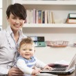 Woman With Baby Working From Home Using Laptop — Stock Photo #11881466