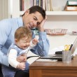 Stressed MWith Baby Working From Home Using Laptop — Stock Photo #11881470