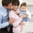 Parents With Baby Working From Home Using Laptop — Stock Photo #11881475