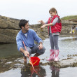 Family with seaweed — Stock Photo #11881582