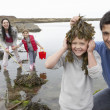 Family with seaweed - Stock Photo