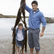 Stock Photo: Father and son on beach