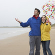 Happy couple on beach - Stockfoto