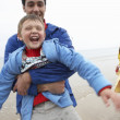 Happy family on beach — Stockfoto #11881636