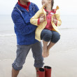 图库照片: Father and daughter on beach