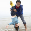 Foto Stock: Happy father with son on beach
