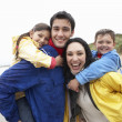 Happy family on beach -  