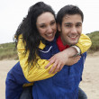 Foto Stock: Happy couple on beach in love