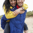 Happy couple on beach in love - Stok fotoğraf