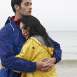 Foto Stock: Couple on beach in love