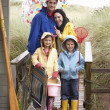 Family on beach with umbrella — Stock Photo #11881699
