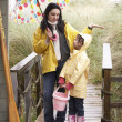 Стоковое фото: Mother and daughter with umbrella