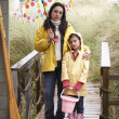 Stock Photo: Mother and daughter with umbrella