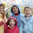 Foto Stock: Children posing with umbrella