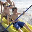 Teenage boys kayaking - Stock Photo