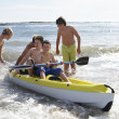 Foto Stock: Teenage boys kayaking