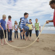 Stock Photo: Teenagers playing skipping rope