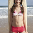 Teenager girl with surf — Stock Photo