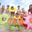 Stock Photo: Teenagers on beach