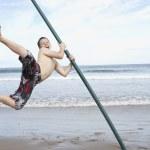 Teenagers playing on beach — Stock Photo #11881789