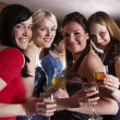 Young women posing at party — Stock Photo