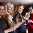 Stock Photo: Young women posing at party