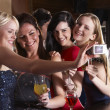 Young women drinking at bar — Foto de Stock