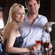 Young couple at bar — Stock Photo #11881843