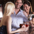 Friends laughing at bar — Stock Photo