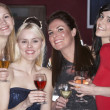 Young women drinking at bar — Stock Photo #11881853