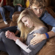 Worried young couple - Stock Photo