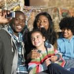 Happy family taking photo — Stock Photo