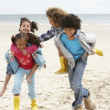 Royalty-Free Stock Photo: Happy children playing piggyback on beach