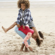Happy children playing on beach — Stock Photo