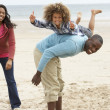 Happy family playing on beach — Stock Photo