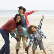 Stock Photo: Happy family playing on beach
